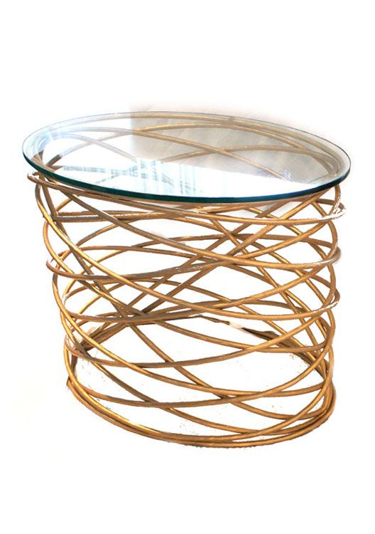BRADLEY 'Bianca' oval side table in French Gold iron finish with a clear glass top.
