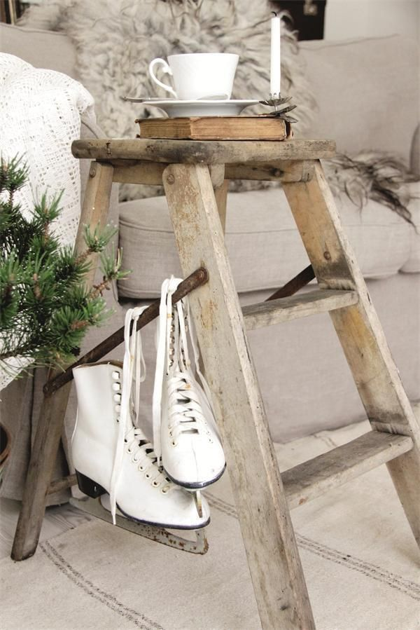 Great side-table use for an old step ladder.... and the ice skates add that warm winter charm