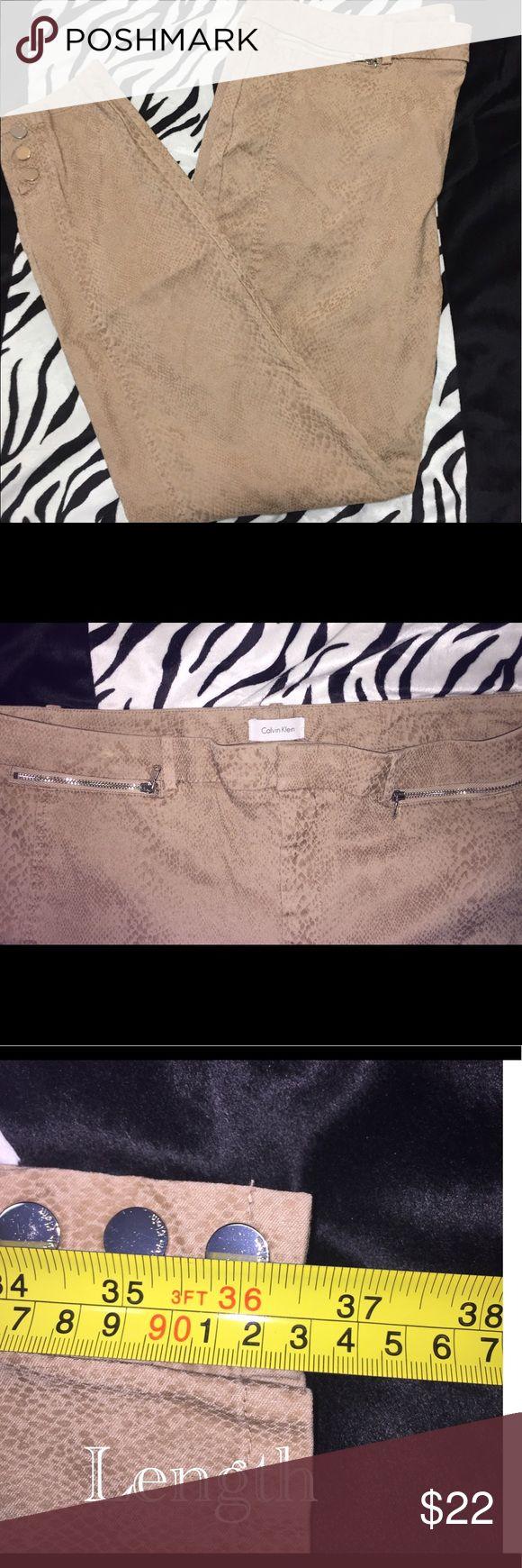 Calvin Klein Tan Snake Print Pants Sz 14 Calvin Klein Tan Snake Print Pants Sz 14. Slight Stretch. Calvin Klein Pants
