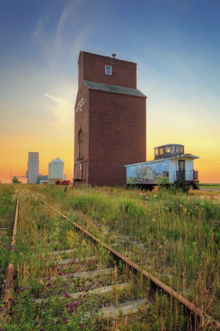 southern Saskatchewan; grain elevator; train tracks; sunset; caboose; Gravelbourg; Western Elevator; wood elevator; Canadian Pacific Railway; Great Western Railway; prairie icon; heritage site; Saskatchewan and Western Elevator Company