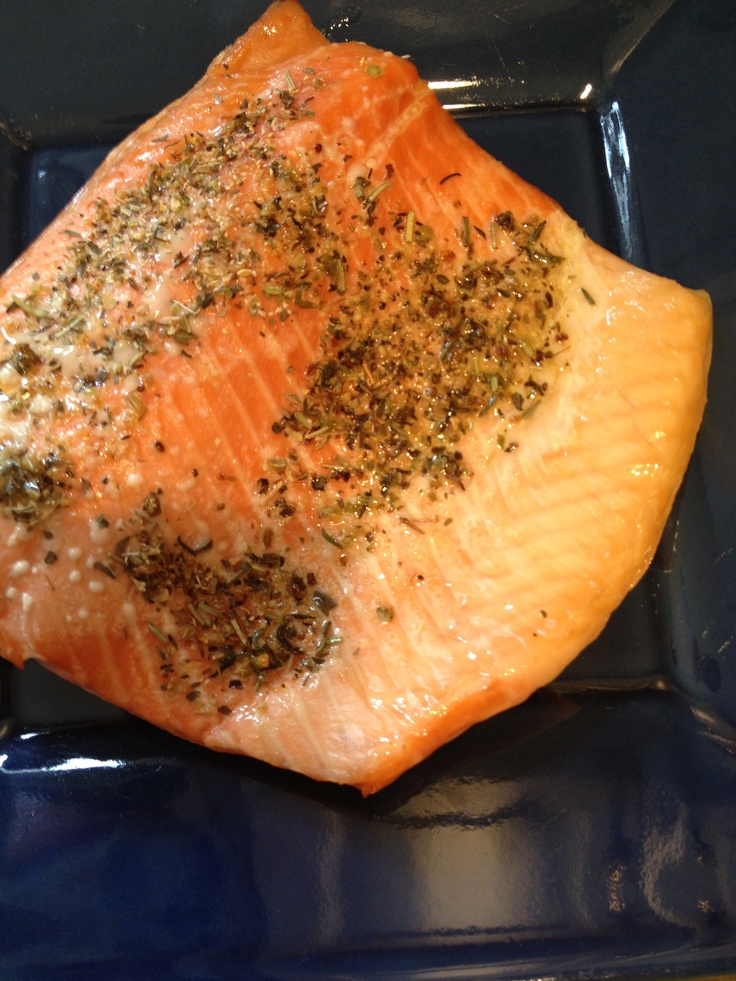 Easy healthy fish dinner: Heat oven to 400. Spray baking dish with low fat cooking spray. Put in 1-inch-thick salmon or steelhead fillets (photo shows steelhead). Top with olive oil, salt and pepper or your favorite seasoning. Roast for 15 minutes (use fork to test if fish flakes easily and remember that fish keeps cooking for a bit after removal from oven). Serve with salad or greens and a healthy starch like brown rice or whole wheat couscous.