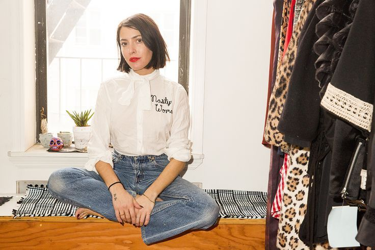 Kat Typaldos decorates with light   Nasty Woman embroidered white blouse by Bad Luck Hand (Luke Good) and vintage jeans