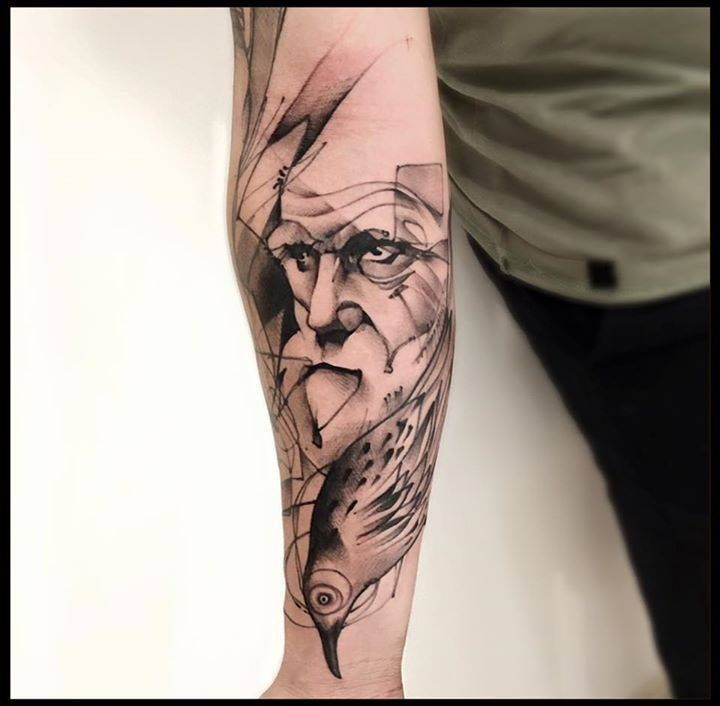 Sketchwork Darwin tattoo on the right inner forearm.
