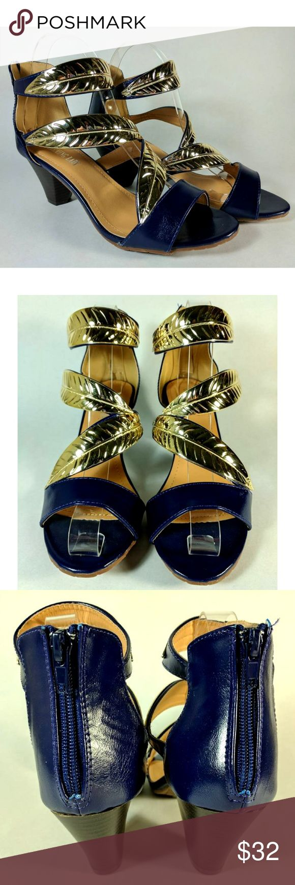 "Charming Lady Blue and Gold Leaf Shoes Size 9 Striking appearance! Kind of a bright navy blue. Leaves are thick plastic, gold color.  Heel measures 2-1/2"" high. Comes with replacement heel caps. Cushioned insole. Zipper back. New in box. Size 9M - Runs true to size. Charming Lady Shoes Heels"