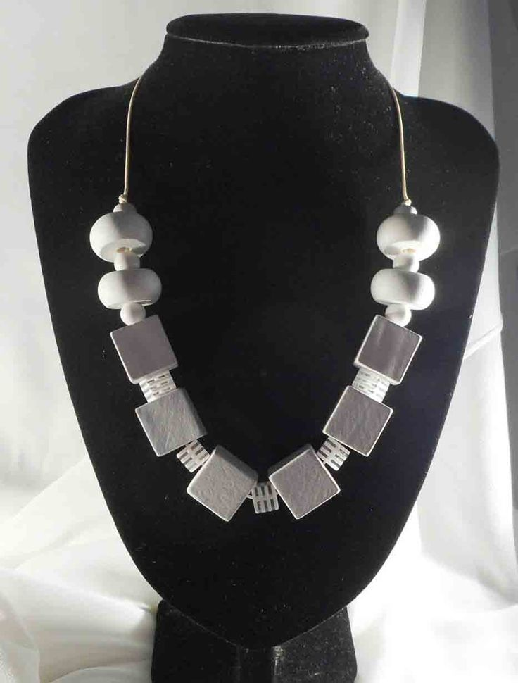 JakDesigns - A beautiful simple necklace in shades of white $40