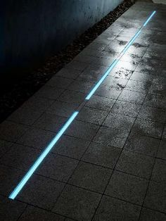 Add outdoor rated strip light channels to sidewalks to combine safety and style. #lightingdesign