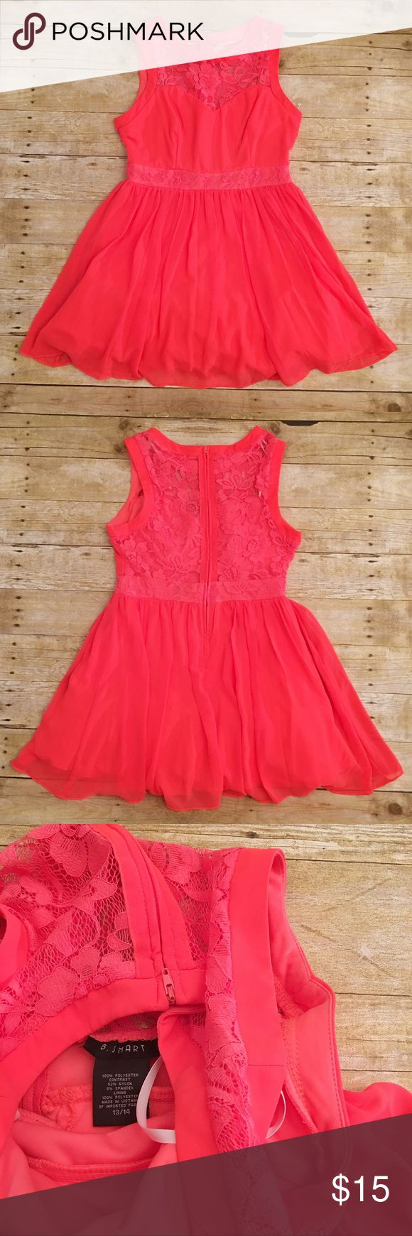 NWOT neon pink B. smart lace dress, 13/14 NWOT neon pink B. Smart dress in a size 13/14. Almost more or a bright orange/pink mix. Like a bright coral. Beautiful full skirt with plenty of tulle underneath. Total length- approximately 32.5 inches, waist- approximately 14.5 inches, bust- approximately 17 inches. B. Smart Dresses Midi