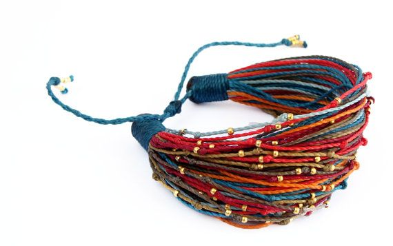 The bracelet is made of waxed polyester cord, decorated with tiny golden beads. The handmade bracelet is easy to adjust by pulling ends of two cords. The