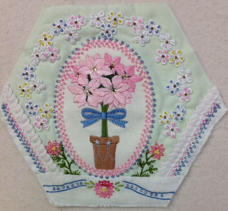 Hexie by Kay Lea. If I remember correctly the center is a machine embroidery design by Embroidery Library.