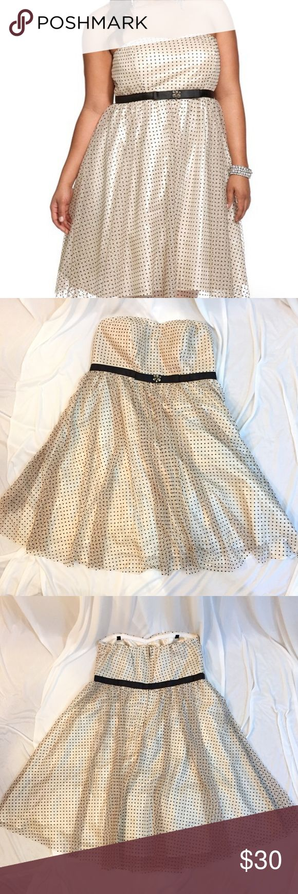 Torrid Polka Dot Party Dress Excellent used condition! This is a beautiful, cream with black polka dot party dress. Strapless, with a sweetheart neckline. Back zip and hook closure. Inner lining and tulle. Happy to answer further questions! torrid Dresses Strapless