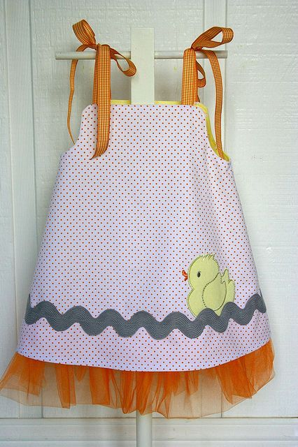 Reverse side of rubber duck Tutu dress    The duck applique design is from www.lynniepinnie.com  Orange dot twill fabric is by Fabric Finders