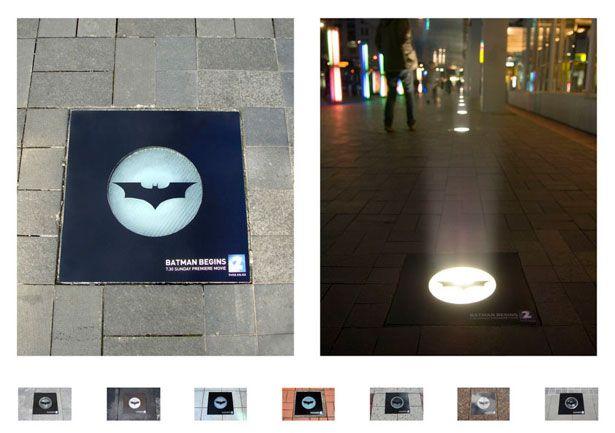"""Per il lancio di """"Batman Begins"""" sulla neozelandese TV2, degli adesivi sono stati collocati sulle luci che illuminano da terra alcune strade nel centro di Auckland. Di sera, accese le luci, si è ricreato così il bat-segnale."""
