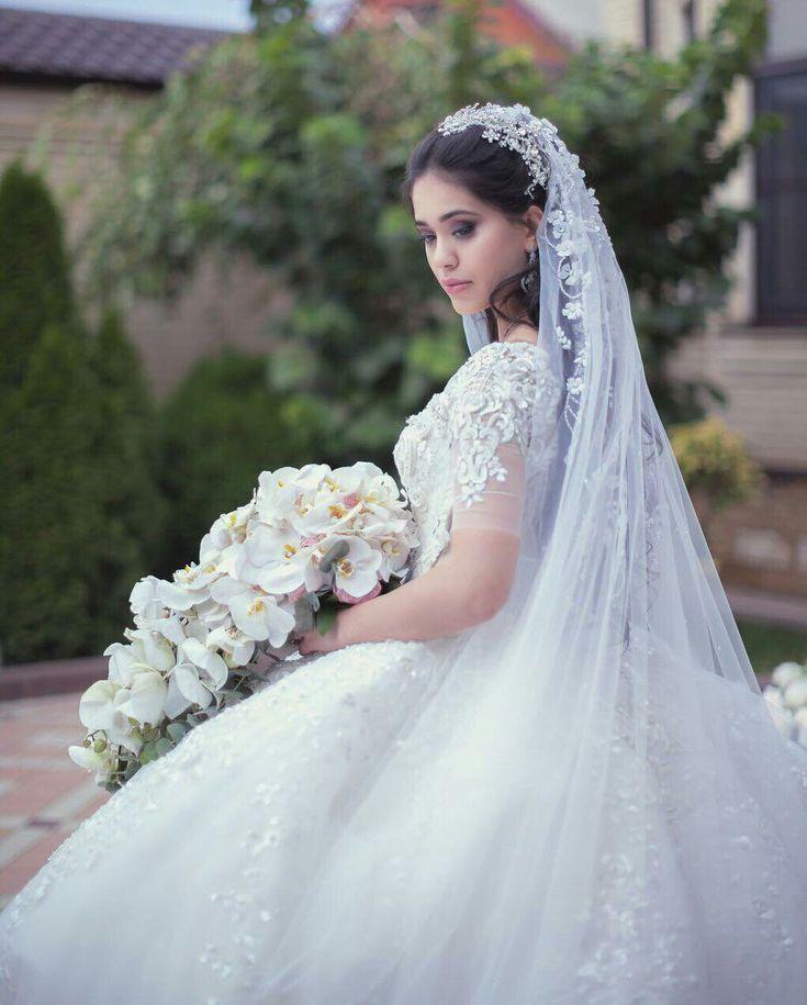 Russian bride in her embellished sheer sleeve