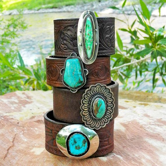 Leather Cuff Bracelet with Old Pawn Turquoise and Vintage Western Belt - Navajo Old Pawn - Turquoise Cuff Bracelet  This leather cuff bracelet was created from a reconditioned, vintage western belt full of rich color and character. We repurposed a beautiful, sterling silver and turquoise pawn piece to serve as the centerpiece of the bracelet. The old pawn piece was originally a sterling silver brooch created by an unidentified Navajo. The turquoise stone is a dazzling blue color and sits in…