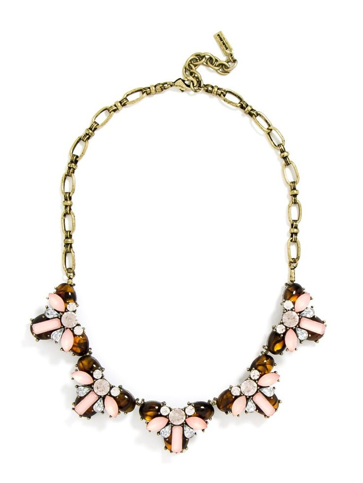 A combination of tortoise shell and whisper pink is buttoned-up classic. Try this preppy necklace with your 9–5 uniform. BaubleBar x Gal Meets Glam Exclusive.