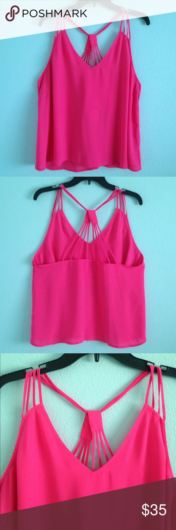 Hot pink strappy tank top New without tags. Hot pink with strappy detail. Flowy fit. Can fit anysize not see through Tops Tank Tops