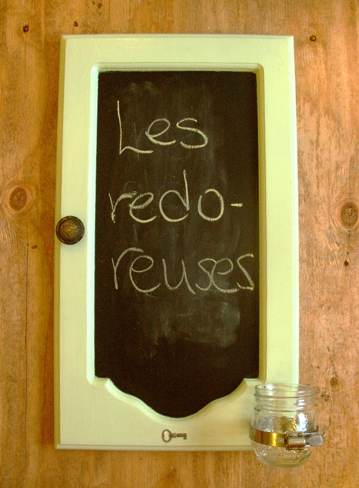 Repurposed kitchen door in to a chalk board with little Mason jar to hold the…
