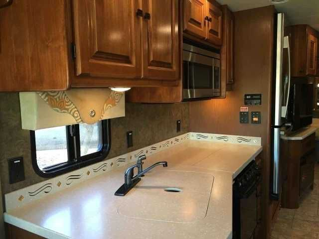 2014 Used Tiffin Motorhomes Allegro Open Road Class A in Alabama AL.Recreational Vehicle, rv, 2014 Tiffin Motorhomes Allegro Open Road , English chesnut cabinets, 15000 A/C w/heat pump, CB antenna, bedroom ceiling fan, bedroom tv, chaise lounge leather driver side, drivers door w/power wind, dash nav/stereo/sat ready, dash OH-TV, fireplace, 7.0 ONAN Generator, exterior tv, gas oven convection/microwave,residential refrigerator with ice maker in freezer,contemporary booth dinette with large…
