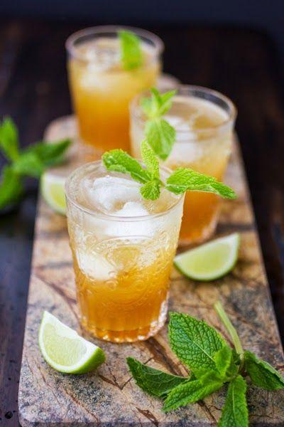Moroccan Mojitos. Black tea, cardamom, sugar, spearmint, lime, lemon, white rum, dark rum