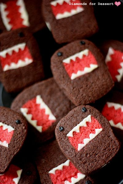 Monster sandwich cookies. Heads-up...these cuties take some effort to create, but they are so worth it for Halloween or birthday parties. There's also a heart cookie variation that would make a wonderful addition to Valentine's Day or Mother's Day celebrations or for wedding or baby showers.