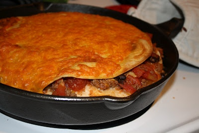 Tortilla Torte: Layers of ground beef, beans and tomatoes; bubbly ...