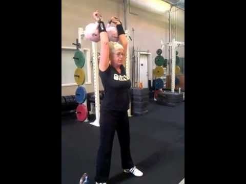 Karen Dutina, 62 year old Ice Chamber lifter, demos double Jerk with 2 x 8kg kettlebells
