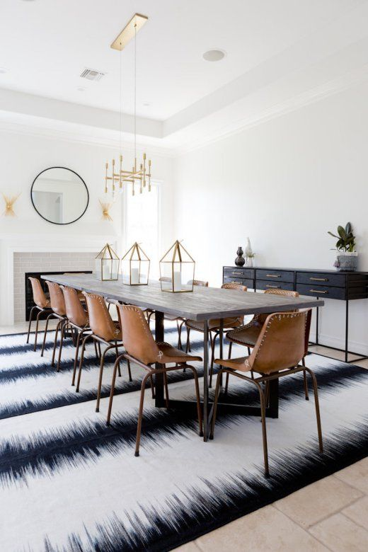Modern Bohemian Dining Room. Sharing my favorite rooms of 2016. Love this ikat rug and leather dining chairs. Modern Boho Chic.