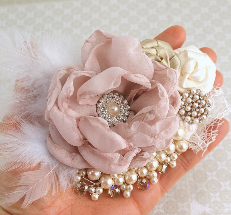 Bridal Hair Fascinator Clip in Blush Pink, Gold, Champagne and Ivory with Feathers, Lace, Pearls and Jewels. $130.00, via Etsy.