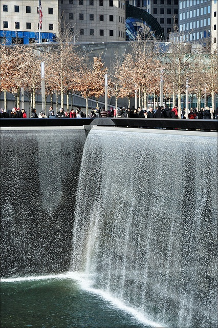 The National September 11 Memorial / New York  Architect: Michael Arad; landscape architect: Peter Walker, 2011.  Walls of tears cascade down the huge footprints left where the twin  towers once stood.  (CC-by-SA which means anyone can freely use any size of this image anywhere,  provided accompanied by the credit: Image: George Rex.)