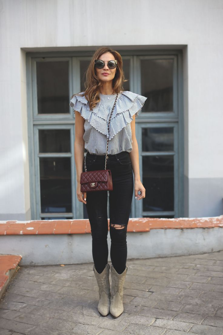 striped shirt looks - Lady Addict. Striped ruffle blouse+black ripped skinny jeans+pale brown cowboy style midi boots+burgundy Chael chain shoulder bag+sunglasses. Spring Casual Outfit 2017