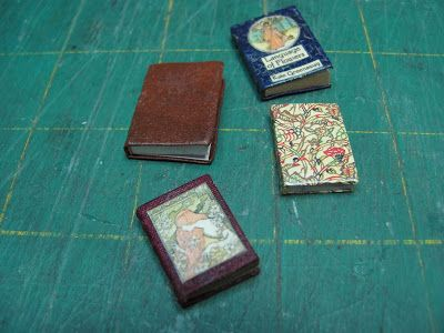 Tutorials | 1 inch minis: how to make miniature books. Good tips: cut the pages as a whole from a memo pad, this allows you to take advantage of the pre-glued top which becomes your interior spine. Also, glue pieces of cotton underneath your cover to add interest to the spine.