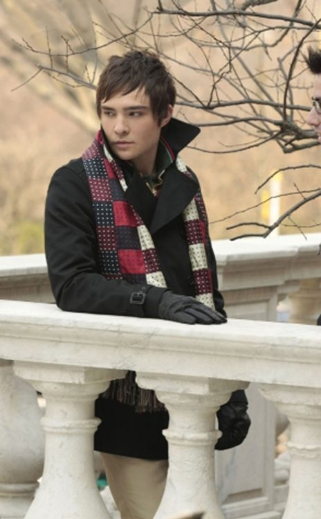 """""""We can't have a Chuck Top 10 without an appearance by the infamous J. Press scarf. A symphony of patchwork silk ties, the scarf became a must-have for any Chuck Bass fan,"""" Daman says of the character's signature accessory. """"After its cult debut the store sold out of them immediately. I love it paired with this plaid Marc Jacobs toggle coat. Boyish innocence meets Bass darkness. A classic."""""""