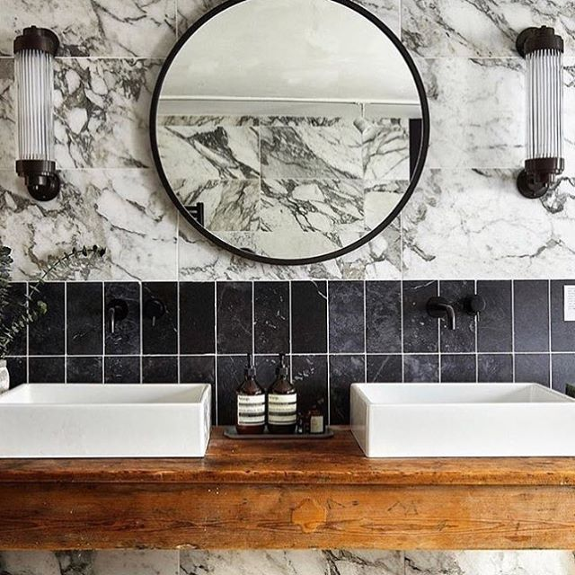 Beautiful #bathroom with the #daveylighting offset pillar lights in hand cast glass and brass. Available today at #dunlinhome