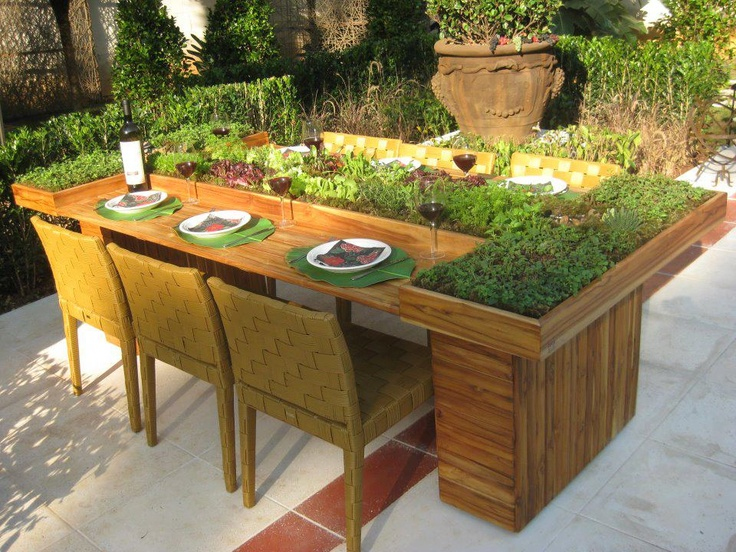 Outdoor dining table with a built in herb garden. House
