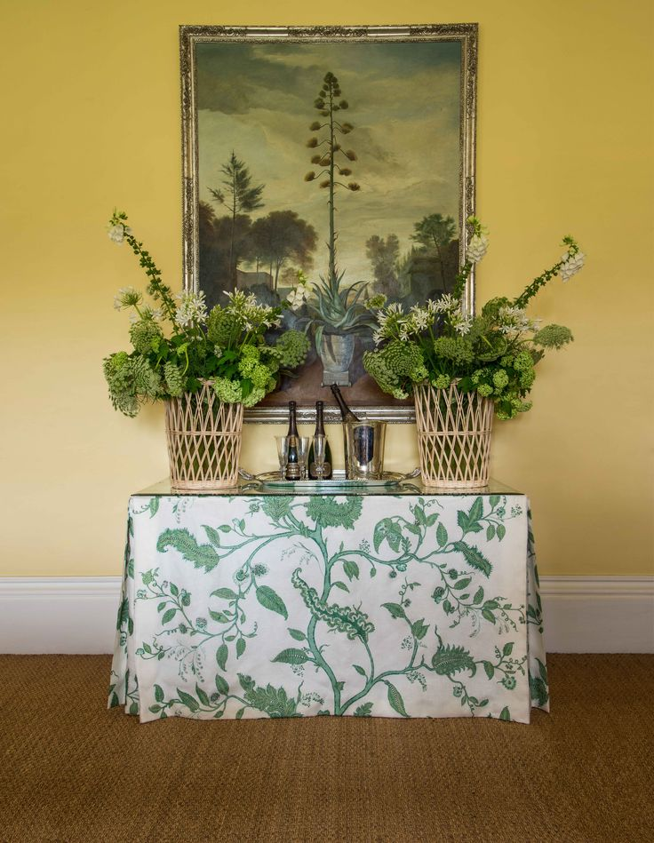 The Hurlingham Rattan Vase and fabric in Tendril Vine Emerald on Linen Sheer, all by Soane Britain.
