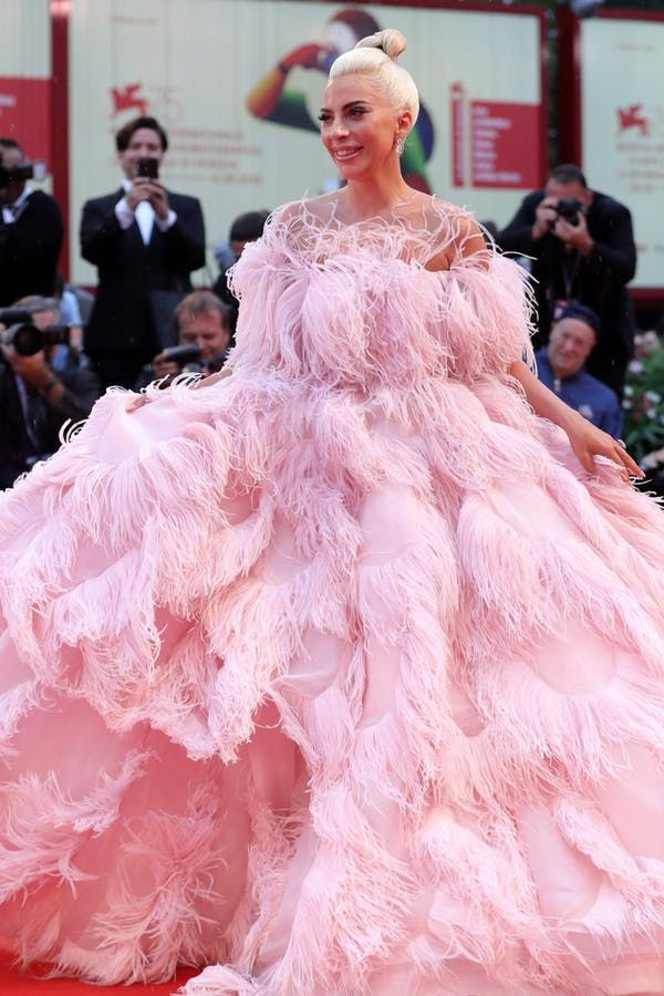 63a6bd28af3 8 of Lady Gaga s Most Jaw-Dropping  A Star Is Born  Press Tour Looks   purewow  news  fashion  celebrity  ladygaga  redcarpetdresses  gowns   dresses ...