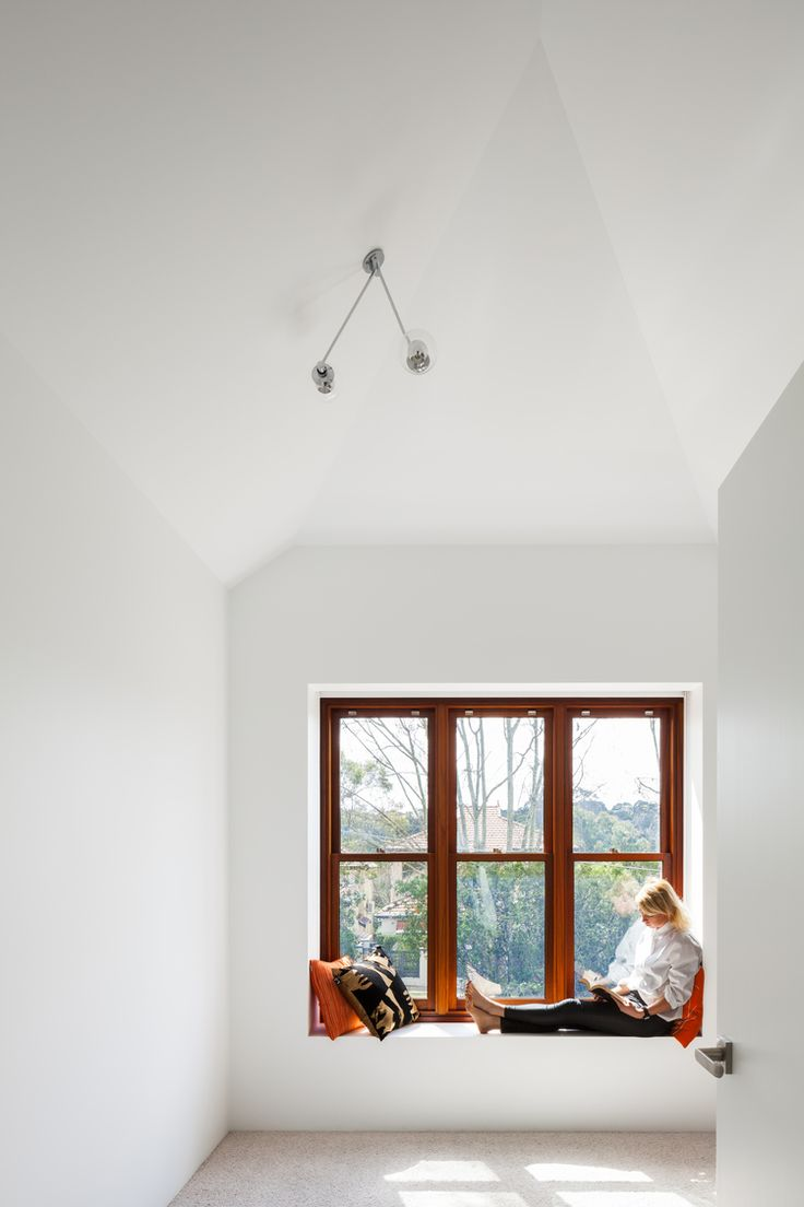 Box timber framed window in white interior at Naremburn House by Bijl Architecture