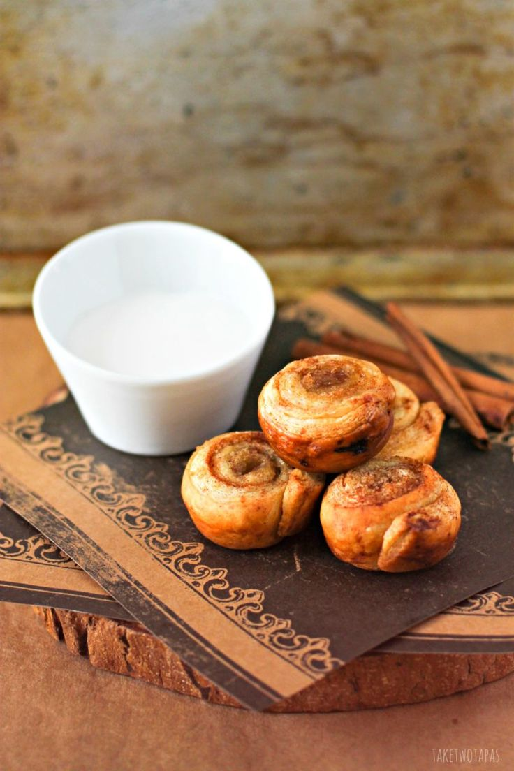 These mini cinnamon roll bites are quickly made with the help of puff pastry. Sprinkled with brown sugar and baked until golden brown, they are crispy on the outside and flaky on the inside. Top them off with vanilla glaze for the perfect bite! Mini Puff Pastry Cinnamon Rolls Recipe | Take Two Tapas
