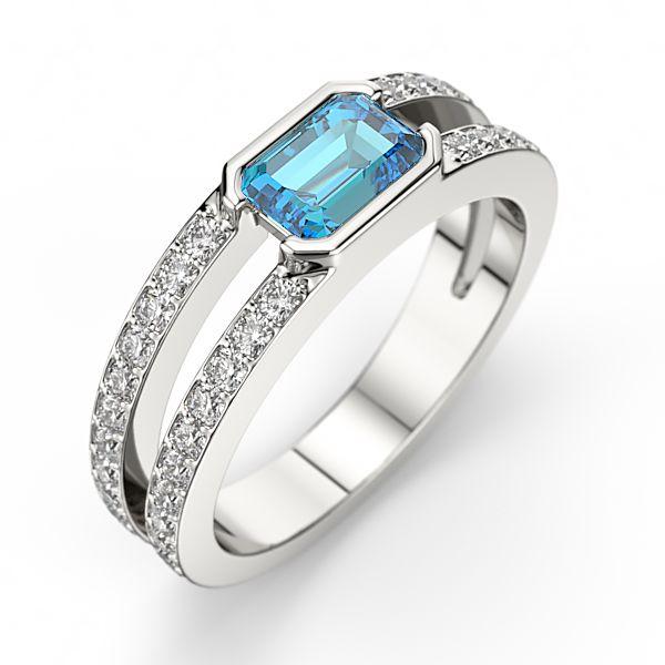 TSARINE, déclinable en Or 18 carats ou Platine 950, est moderne et pleine d'élan, serti d'une pierre centrale taille émeraude, elle vous offre la possibilité de choisir la couleur de votre pierre, précieuse ou semi précieuse,et est mise en valeur par des lignes de 48 diamants de 0.48 carat qualité GSI.  [1280,00€]