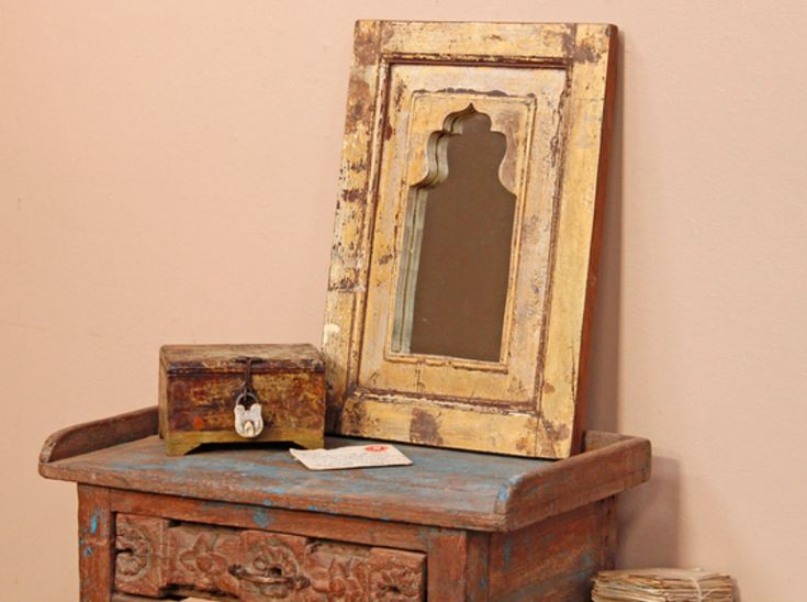 A lovely cream-colured rustic bedroom mirror with a stunning paint-distressed surface finish. Its attractive ornate profile reflects its Northern Indian origin. #vintage #mirror #unique #furniture #homedecor #homestyle