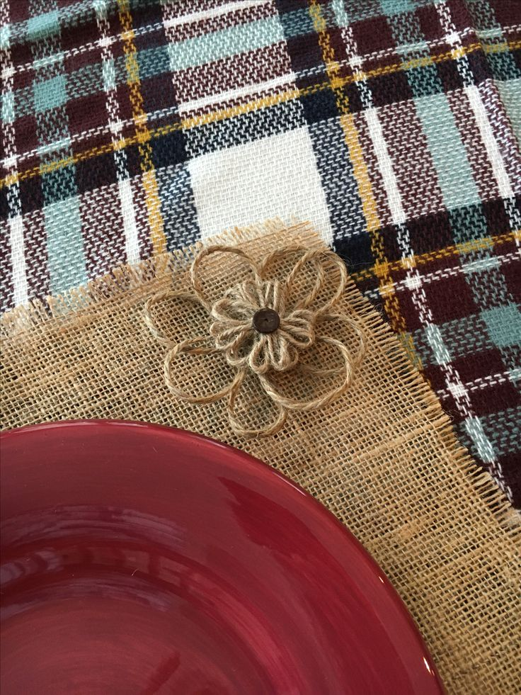 Cut out your own burlap placemats, add jute flowers and set over a plaid blanket scarf or throw.  I bought jute flowers, but they were too small so I added my own extra jute loops to the back to make them larger.