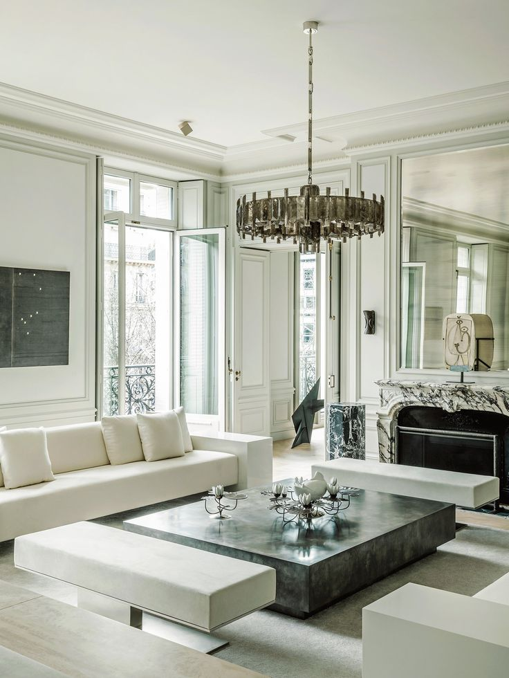 Two apartments on Avenue Montaigne joined together and design by Joseph Dirand | Photograph by Martin Morrell | Living room with Mathieu Lustrerie chandelier, Dirand designed lounges as an homage to Eileen Gray