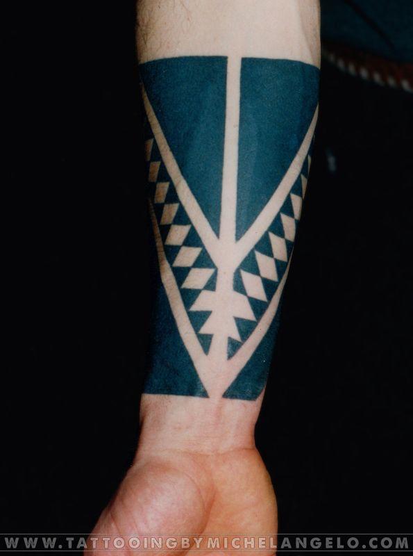 Hawaiian style inspired forearm tattoo