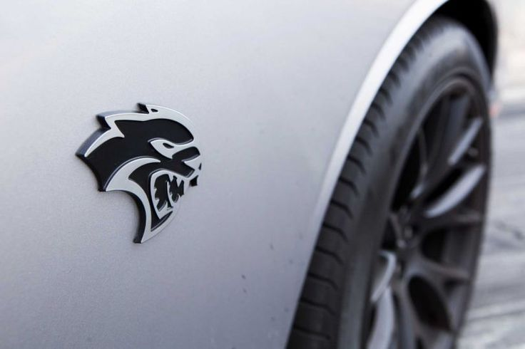 View of the 2015 Dodge Challenger SRT Hellcat logo on the ...