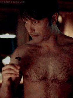 Shirtless Dr. Hannibal Lecter...eating (it might be people but it sure is sexy...)