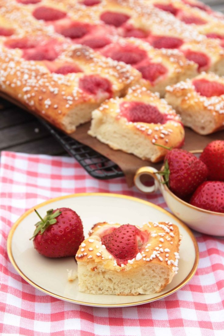 Strawberry buns in the pan - yeast buns with a little dab of filling and strawberry in each square. Great for a large group or gettogether