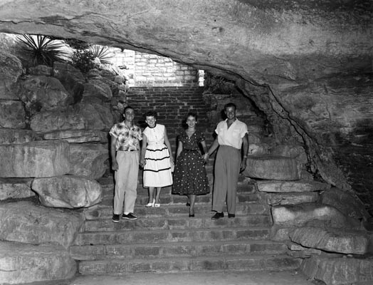 "Foursome photo op at the entrance to the cavern at Longhorn Cavern State Park, Burnet, Texas circa 1950s. The Cavern still operates daily with tours and features ""Concerts in the Cavern"" with well known singer/songwriters from all genres."