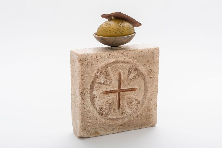 Stone candle holder with golden accents.