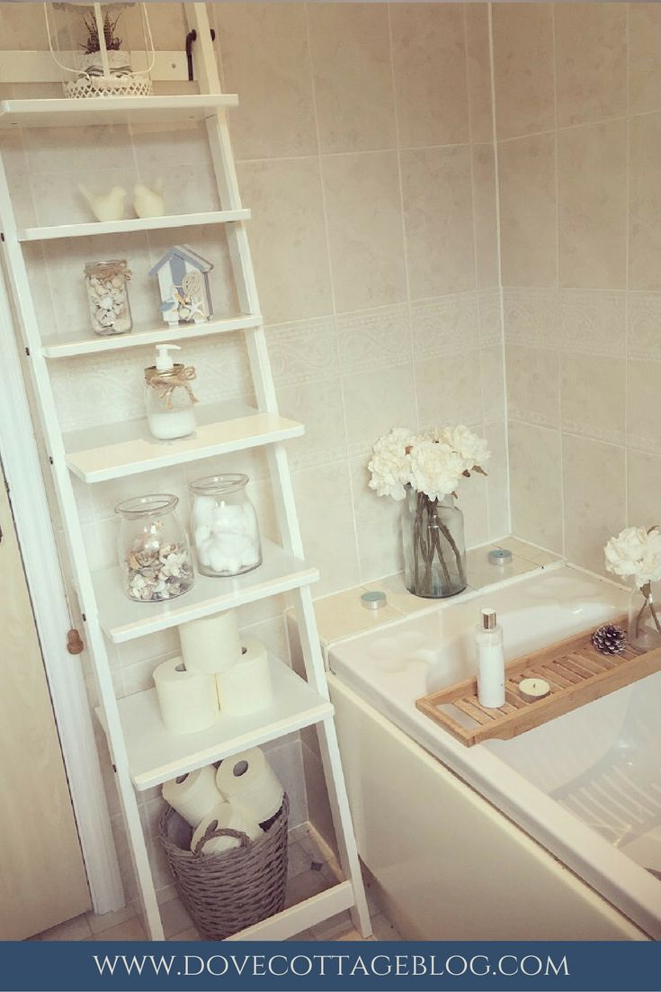 Vintage Style Bathroom In Neutral Colours With Hints Of Nautical Themed  Accessories. Ladder Shelving