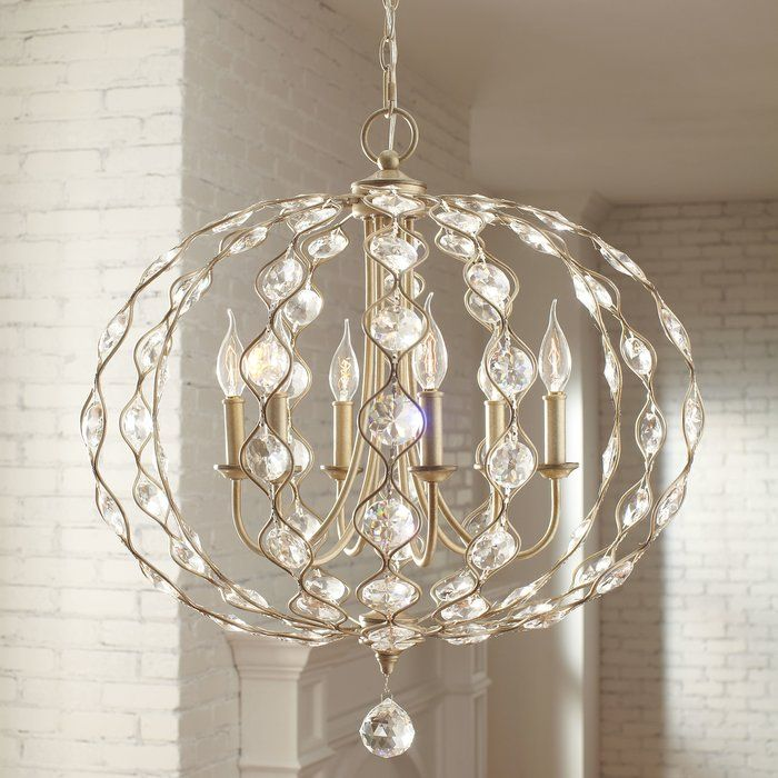 Full of radiance and sparkle, this round chandelier features delicately arranged crystals and a steel frame.